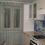 Какие шторы повесить на кухне